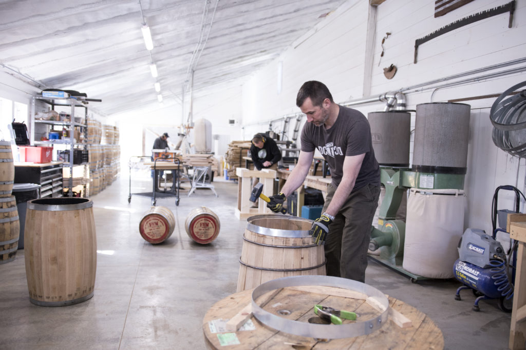 Man building an oak barrel grain cooperage