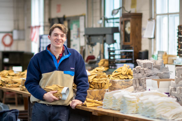Sam Hooper standing in Vermont Glove factory